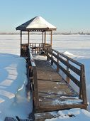 picture of gazebo  - Wooden gazebo and planked footway by the river at winter - JPG