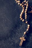 pic of prayer beads  - rosary beads on old black background - JPG