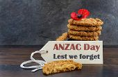 picture of slating  - Australian Anzac biscuits with Anzac DAy Lest We Forget message on dark wood and slate background - JPG