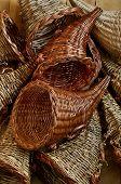 stock photo of cornucopia  - Background of multiple empty cornucopia wicker baskets - JPG