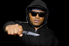 pic of hoodie  - thug wearing a hoodie and holding a knife coming out of the shadows - JPG