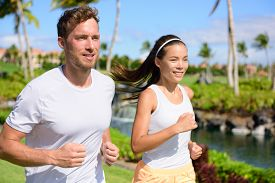 picture of jogger  - Jogging couple of runners running together in park - JPG