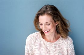 image of shy woman  - Close up portrait of a beautiful mid adult woman laughing with sweater - JPG
