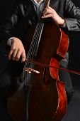 stock photo of cello  - Man playing on cello close up - JPG
