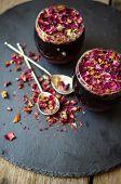 image of rose bud  - Rose bud tea in the vintage spoons on the black stone desk - JPG