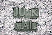 pic of junk  - junk mail phrase made from metallic letterpress type inside of shredded paper heap - JPG