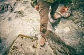 pic of survival  - Feet Man trekking boots hiking outdoor with river and stones on background Lifestyle Travel survival concept top view - JPG