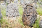 image of stone sculpture  - Lava stone sculpture of an old man - JPG
