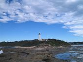 Lighthouse And Blue Skies