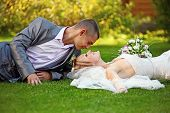 Portrait of happy newlyweds on grass