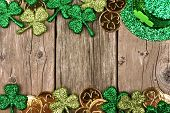 St Patricks Day Double Border Of Shamrocks, Gold Coins And Leprechaun Hat Over Rustic Wood poster