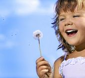 picture of cute little girl  - little girl closeup portrait with dandelion - JPG
