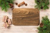 Wood Cutting Board At Table Background With Christmas Decoration, Round Board. New Year Concept poster