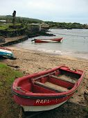 Red boat in a little sandy bay of Easter Island