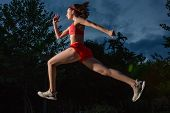 Young Happy Woman Running Outdoor In A City Park. Girl Running Running In The Nature To Lose Weight  poster