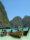 Three traditional Thai boats in the Maya Bay of Phi-Phi island