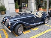 Vintage roadster on block-stone street of the historical center of Bern, Switzerland
