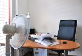 pic of leaf-blower  - Fan in the office leafing a book - JPG