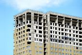 Process Of Construction High-rise Modern Apartment Building With Flat Roof And Penthouse Over Blue S poster