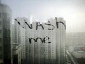 Wash Me Text On Dirty Window. Cleaning Concept - Wash Me Words On Dirty Window. Dirty Window In The  poster