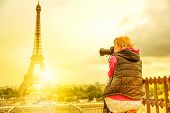 Photographer On Place Du Trocadero Of Tour Eiffel At Sunset. Traveler Woman In Paris, France, Europe poster