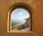 stock photo of promontory  - arched window on the coastal landscape of a bay - JPG