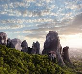 sunset on monastery Agias Varvaras Roussanou on top of rock Meteora, Greece