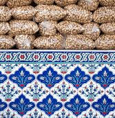 peanuts stacked in plastic bags and decorated ceramics of Iznik