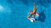 Aerial Top View Of Beautiful Girl In Swimming Pool From Above, Relax Swim On Inflatable Ring Donut A poster