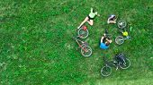 Family Cycling On Bikes Outdoors Aerial View From Above, Happy Active Parents With Child Have Fun An poster
