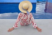 Summertime. Woman Relaxing At The Swimming Pool. Chill Out. Horizontal poster
