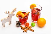 Traditional Winter Beverage With Cinnamon Sticks And Orange Fruit. Glasses With Mulled Wine Or Hot D poster