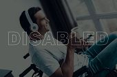 Disabled Man In A Wheelchair. Man Sits In Front Of Window. Man Looks Into Window. Man Listening Musi poster
