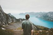 Man Adventurer Admiring Fjord And Mountains View Travel Lifestyle Adventure Concept Vacations Outdoo poster