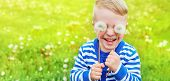 Happy Kid Laughing. Emotion Face Joy Child, Close Up Portrait. Little Boy Smiling, Dandelions On Eye poster