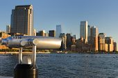 The Lower Manhattan Skyline with a telescope for detailed viewing.