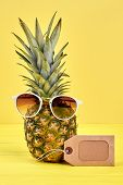 Pineapple With Sunglasses On Color Background. Fresh Ananas With Sunglasses And Blank Price Tag On Y poster