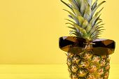 Ananas In Male Sunglasses And Copy Space. Fresh Juicy Pineapple Fruit Wearing Sunglasses With Dark G poster