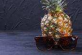 Hawaiian Pineapple And Sunglasses On Dark Background. Fresh Juicy Ananas And Sunglasses With Copy Sp poster