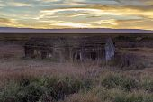 Sunset Over Abandoned House At Drawbridge, The Last Remaining Ghost Town In San Francisco Bay Area.  poster