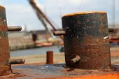 rusty mooring post on the deck of  a ship