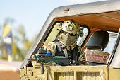 Soldier Assault Rifle With Silencer, Optical Sight In The Car. Army Exercises. War, Army, Technology poster