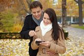 Couple Navigating With Smartphone