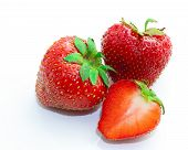 Red Berry Strawberry Isolated On White Background. Slices Of Strawberry On White. Juicy Strawberries poster