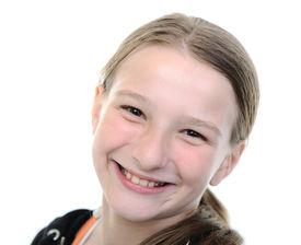 stock photo of ten years old  - Cute blond school girl portrait - JPG