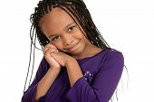 foto of cornrow  - isolated cute african child with purple top - JPG