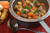 image of stew pot  - Photo of of Irish Stew or Guinness Stew made in an old well worn copper pot - JPG
