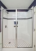 elegant modern shower with purple tile accents