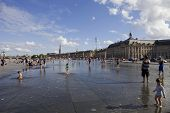 BORDEAUX, FRANCE - AUGUST 8: Bordeaux water mirror full of people in one of the hotest summer days, having fun in the water, on August 8, 2012 in Bordeaux, France.