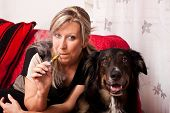 Blonde Woman With Dog And Electric Cigarette